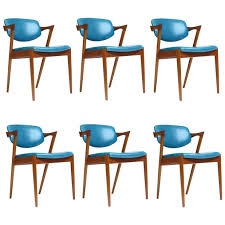 six kai kristiansen teak danish dining chairs in turquoise leather