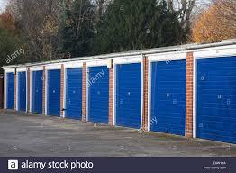 car garages on a housing estate birmingham england uk stock