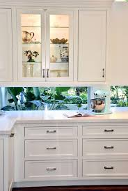kitchen archives waterview kitchens white floating cabinets with window backsplash with dark cherry island