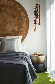 Circle Hanging Bed by Wood Elements And A Beautiful Rug Hung On The Wall As A Headboard