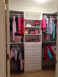 classic small white wooden walk in closet for kids bedroom with 5
