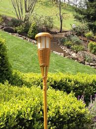 great tiki torches for your backyard bar or barbecue outdoor bar