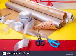 wrapping boxes gift wrapping boxes paper ribbon and scissors on color