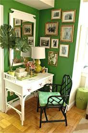 tropical home office in the corner with green walls and wall