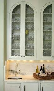how to put chicken wire on cabinet doors chicken wire cabinet doors diy how to put in kitchen cabinets