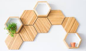 recycled chopsticks are turned into these honeycomb shelves and