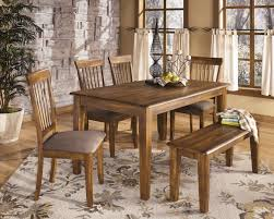 floral pattern rug under rectangle clear coating dining table with