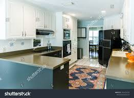 small kitchens with white cabinets small kitchen white cabinets tiled floor stock photo edit