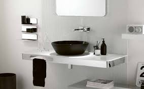 interior of small white bathroom with sink shower and toilet with