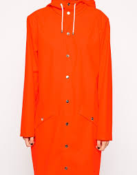 rains long jacket in bright orange in orange lyst