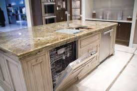 pictures of kitchen islands with sinks flat island two dishwashers sink should there be a ledge or