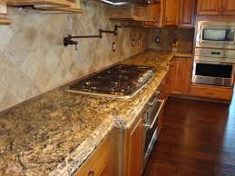 Unlimited Outdoor Kitchen Cream Black Granite Counter Top With Stove On The Brown Wooden