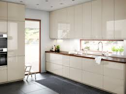 a medium size kitchen with light beige high gloss doors and