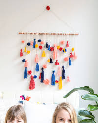 how to make this ridiculously adorable pom pom tassel wall hanging
