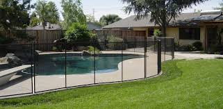 glossy glass pool fence ideas around large aquamarine water plus