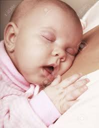 adorable baby on on mothers chest stock photo