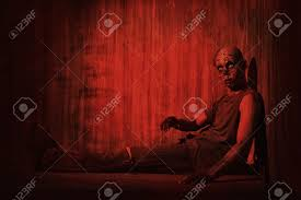 frightening bloody zombie man in blood red light halloween stock