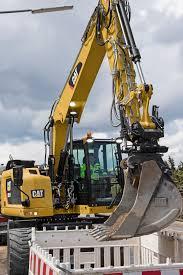 caterpillar intros m315f m317f wheeled excavators with tool