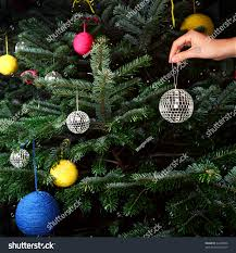 shown putting disco ornament stock photo 42460309