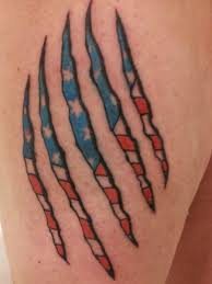 Ripped American Flag Tattoo Collection Of 25 Grey Ink Arrow Ripped Skin Tattoo On Muscles