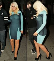 christina aguilera suffers wardrobe malfunction as she heads out