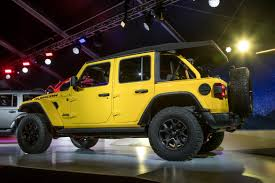 power wheels jeep yellow how will jeep make the 2020 wrangler a plug in hybrid news