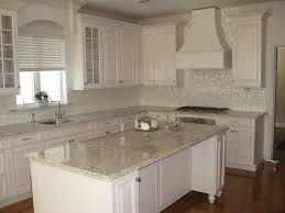 mosaic tile kitchen backsplash with white cabinets travertine