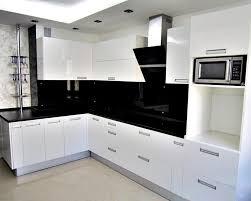 white cabinets black countertops kitchen black counters white