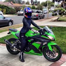 womens motorcycle race boots annette carrion atop her kawasaki ninja proves that flattering