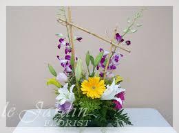 orchid flower arrangements tropical flower arrangements le jardin florist 561 627 8118