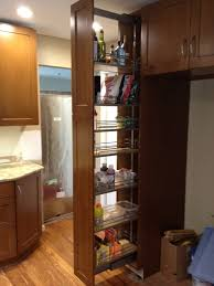 kitchen pull out cabinet brown polished oak wood pul out storage oantry with chrome metal
