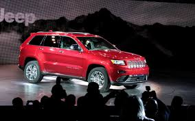 orange jeep grand cherokee 2014 jeep grand cherokee first look motor trend