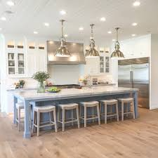 kitchen island with seating area see this instagram photo by caitlincreerinteriors 2 352 likes