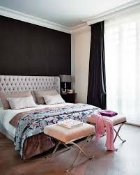 black walls in bedroom black accent wall tufted wing headboard ottomans home inspired