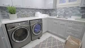 interior design u2014 small storage filled blue grey laundry room