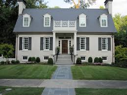 painted brick houses with wood doors light grey with white