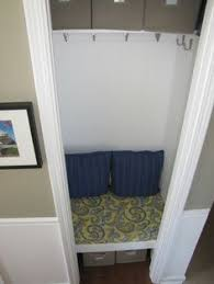 a small closet is transformed into an entry nook with board