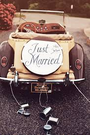 just a car for the antique brown car with a just married sign with tin cans from