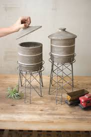 best 25 primitive canisters ideas on pinterest canisters set 2 grey wash clay water tower canisters w raw metal base