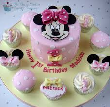 minnie mouse birthday cake minnie mouse 1st birthday cake with matching minnie cupcak flickr