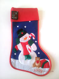 christmas stitched stockings in santa snowman or reindeer design