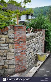 Stone For Garden Walls by Building A Garden Wall With Cotswold Stone And Cement Mortar With