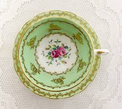 vintage china with pink roses vintage green and gold tea cup and saucer with pink roses by