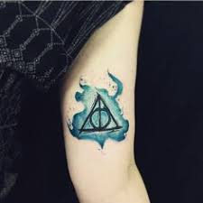 deathly hallows symbol tattoo on the left inner forearm film