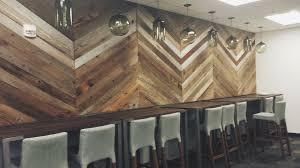 chevron wood wall commercial interiors alibi interiors