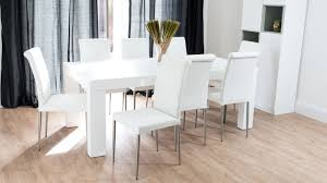 oak wood dining table in white color feature clear glass vase and