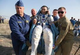 three astronauts land back on earth in soyuz capsule