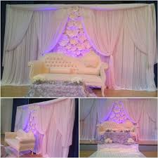 paper flower backdrop for a nigerian traditional wedding ceremony