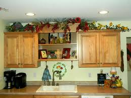 Decorating Above Kitchen Cabinets Pictures by What To Put Above Kitchen Cabinets Granite Countertop Brown Wood