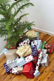 photo of large collection of christmas gifts under a tree free
